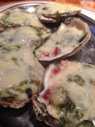 Oysters Rockefeller are topped with an abundance of cheese.